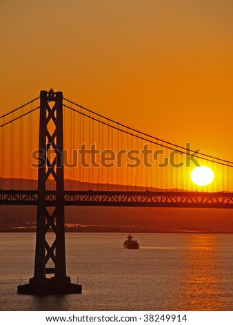 The Sunrise above Bay Bridge. - stock photo