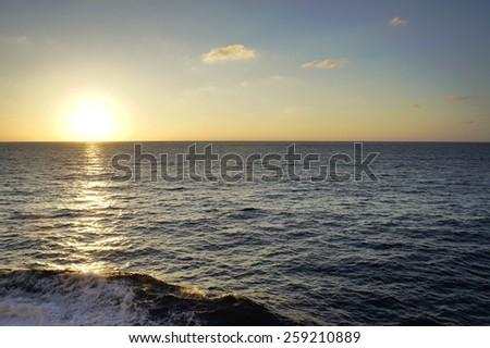 The sunrise from ocean horizon - stock photo