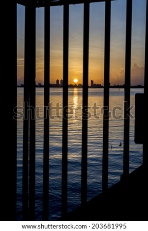 The sunrise over Biscayne Bay in Miami, Florida. - stock photo