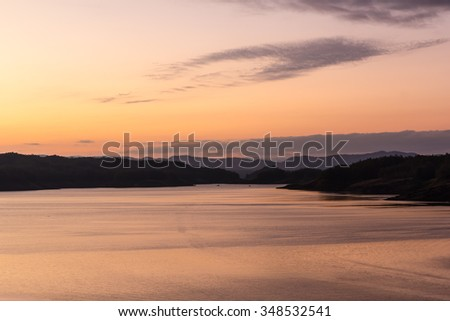 the sunset at Sirikit Dam