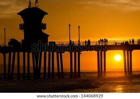 The sunset at the pier in Huntington Beach,CA on a June evening. - stock photo