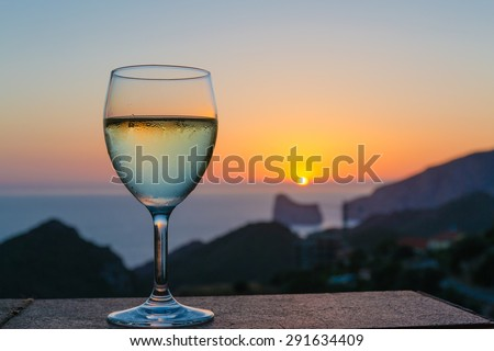 The sunset in the glass - stock photo