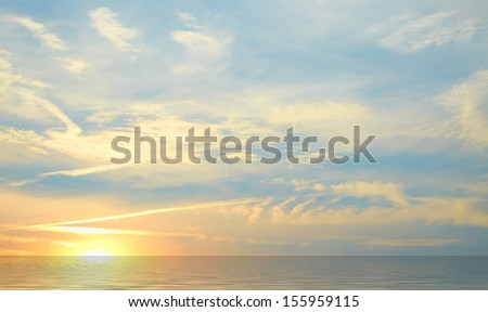 The sunset on the sea coast in Greece - stock photo