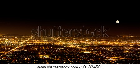 The Super Full Moon on May 5, 2012 over the city light of Phoenix Arizona. Photograph was taken from the top of South Mountain. - stock photo