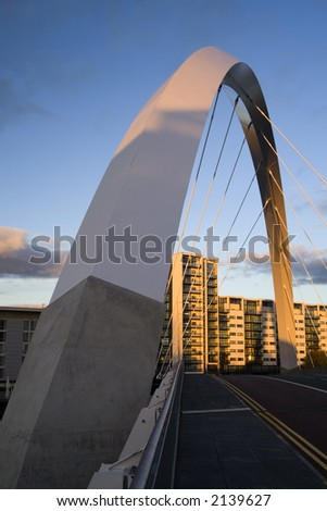 The supporting arch of the Clyde Arc bridge in Glasgow, Scotland, lit at sunset
