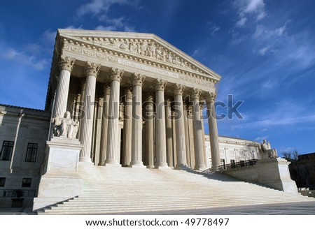 The Supreme Court building in Washington DC in warm afternoon light. - stock photo