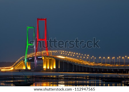 The Suramadu Bridge at Twilight,Surabaya,Indonesia.Is the longest Bridge  in Indonesia. - stock photo