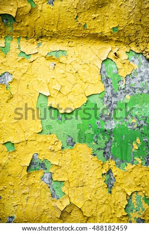 the surface is covered with cracked yellow paint