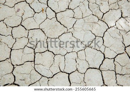 The surface of crack dry clay sold background - stock photo