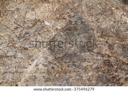 The surface of natural stone used as a background.