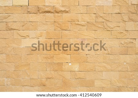 the surface stone Cladding brick wall, beautiful brick wall, the orange stone cladding brick wall of the building, Clams stacked stone wall nicely, background texture - stock photo