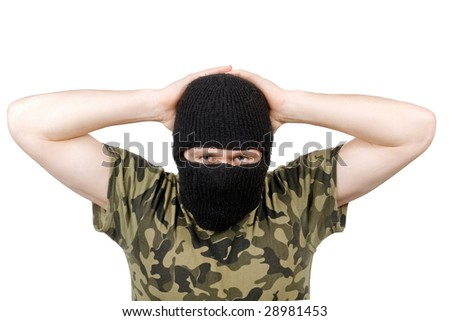 The surrendered terrorist in a black mask over white - stock photo