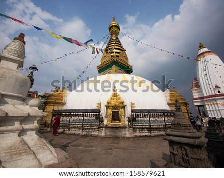 The Swayambhunath stupa, popularly known as the Monkey Temple, an important pilgrimage site for both Buddhists and Hindus in Kathmandu, Nepal. - stock photo
