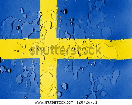 The Swedish flag  covered with water drops