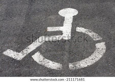 the symbol handicapped on a parking space
