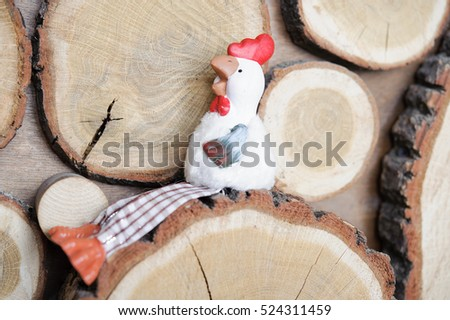 the symbol of the new 2017 rooster on wooden background