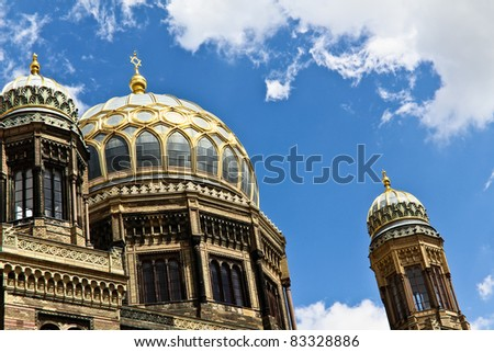 The synagogue under blue sky with clouds in Berlin shining in gold - stock photo