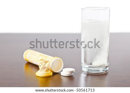 the table dissolving in water - stock photo