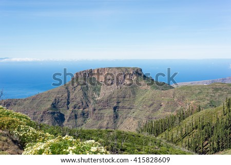 The tableland La Fortaleza on the canary island La Gomera. The mesa is a landmark on the island. La Fortaleza de Chipude reaches a height of 1243 meters, and its diameter is 300 meters - stock photo