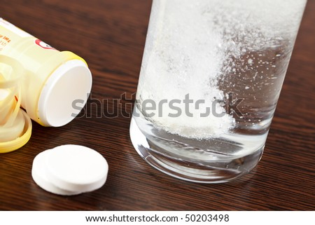 the tablet dissolving in water - stock photo