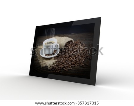 The tablet with coffee a cup on the screen - stock photo