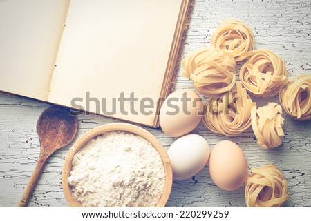 the tagliatelle pasta with cookbook - stock photo
