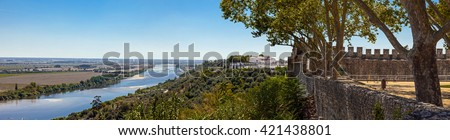 The Tagus River (Rio Tejo), the largest of the Iberian Peninsula, and the Leziria landscape seen from castle walls in Portas do Sol belvedere. Santarem, Portugal. - stock photo