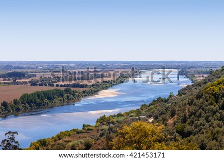 The Tagus River (Rio Tejo), the largest of the Iberian Peninsula, and the Leziria landscape seen from Portas do Sol belvedere. Santarem, Portugal. - stock photo