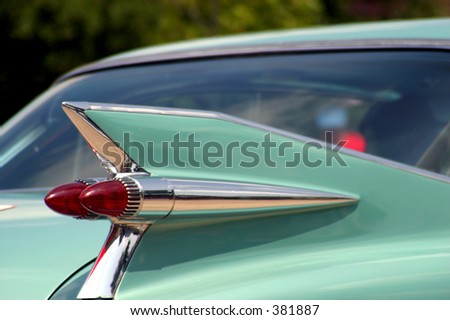 The tail fin of a classic automobile.