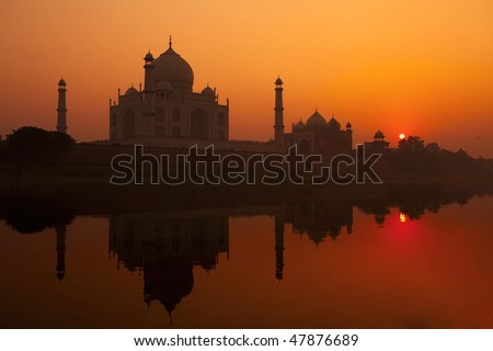 The Taj Mahal from across the yamuna river - stock photo