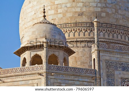 The Taj Mahal is a mausoleum located in Agra, India. It is one of the most recognizable structures in the world. - stock photo