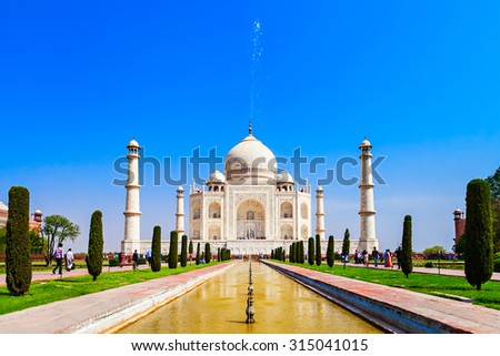 The Taj Mahal is a white marble mausoleum located in the Indian city of Agra. It is one of Seven Wonders of the World. - stock photo