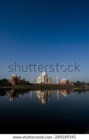 The Taj Mahal is a white marble mausoleum located on the southern bank of Yamuna River in the Indian city of Agra - stock photo