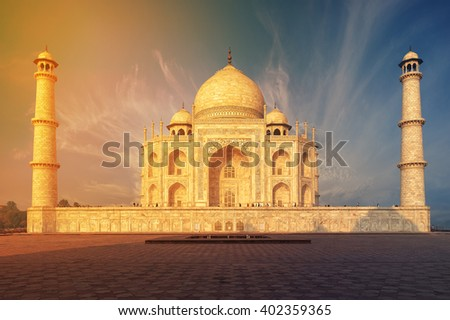 The Taj Mahal is an ivory-white marble mausoleum on the south bank of the Yamuna river in the Indian city of Agra, Uttar Pradesh. - stock photo