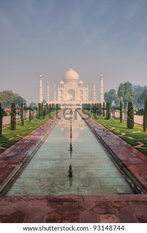 The Taj Mahal reflected in the water pool in front of it in Agra, India - stock photo