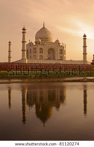 The Taj Mahal reflecting in the Yamuna river at sunset. - stock photo