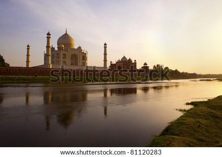 The Taj Mahal, Yamuna river at sunset. - stock photo