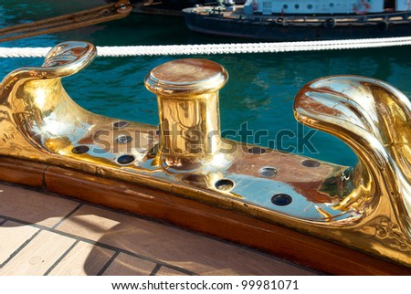 The tall brass ship rigging. Old yacht equipment