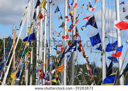 The tall chips and the marine flags in the sky background - stock photo