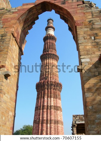 The tallest brick minaret tower in the world at Qutub Minar monument in New Delhi, India - stock photo