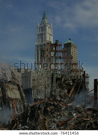 The tallest building in the world from 1913-1930 the Woolworth Building stands behind the World Trade Center ruins on 9-18-2001 - stock photo