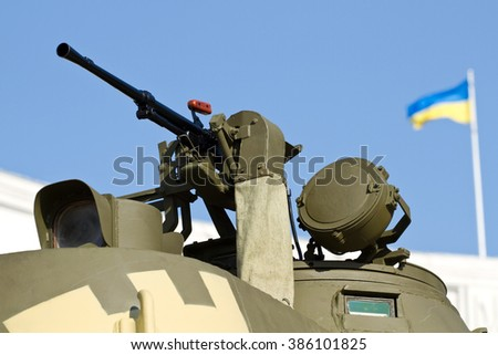 The tank with a machine gun and a Ukrainian flag