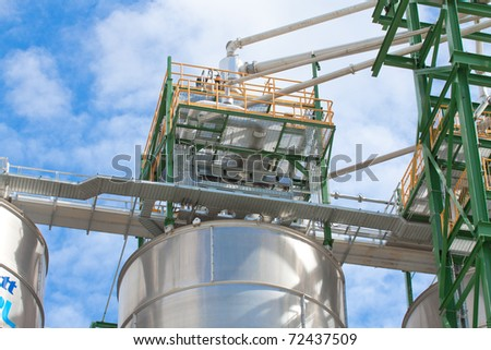 The tanks that storage the polyethylene inside before loading with the pipelines to the petrochemical plant to makes raw plastic material - stock photo