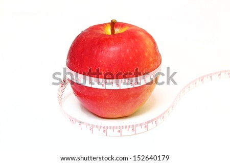 The tape measure of body good health with a red apple - stock photo