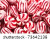 the tasty red white bonbons - stock photo