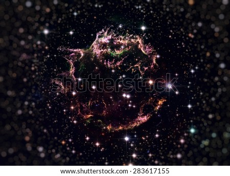 The tattered remains of a supernova explosion known as Cassiopeia A. It is the youngest known remnant from a supernova explosion in the Milky Way. Elements of this image furnished by NASA. - stock photo
