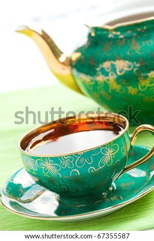 the tea in antique porcelain mug - stock photo