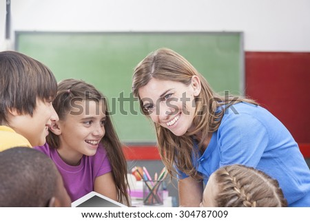 The teacher showing something