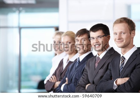The team members shoulder to shoulder each other - stock photo