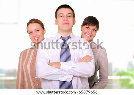 The team of young successful business people in the office workplace. - stock photo